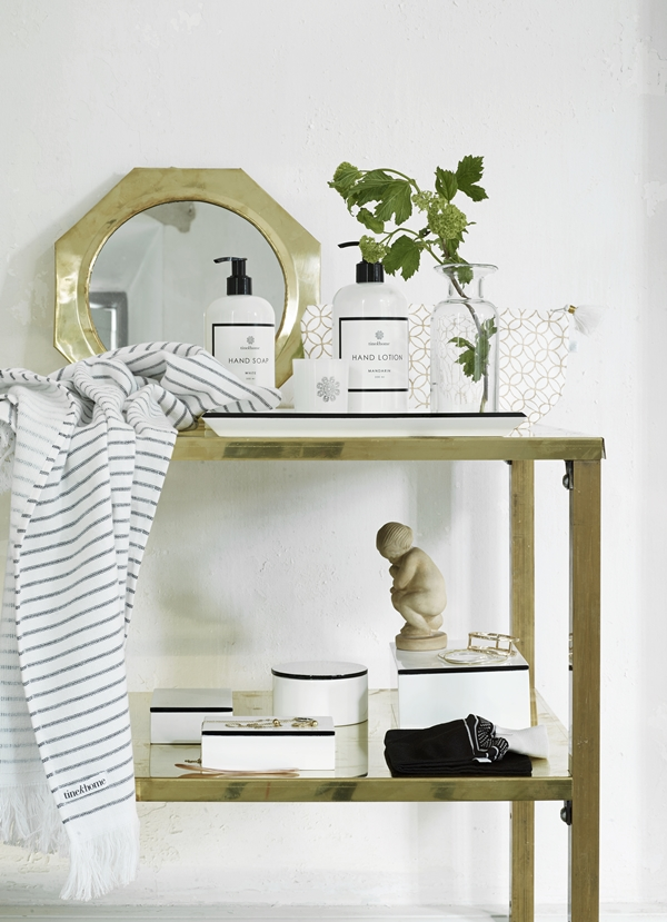 bathroom-with-brass-mirrors-and-soft-stripes-towels_high